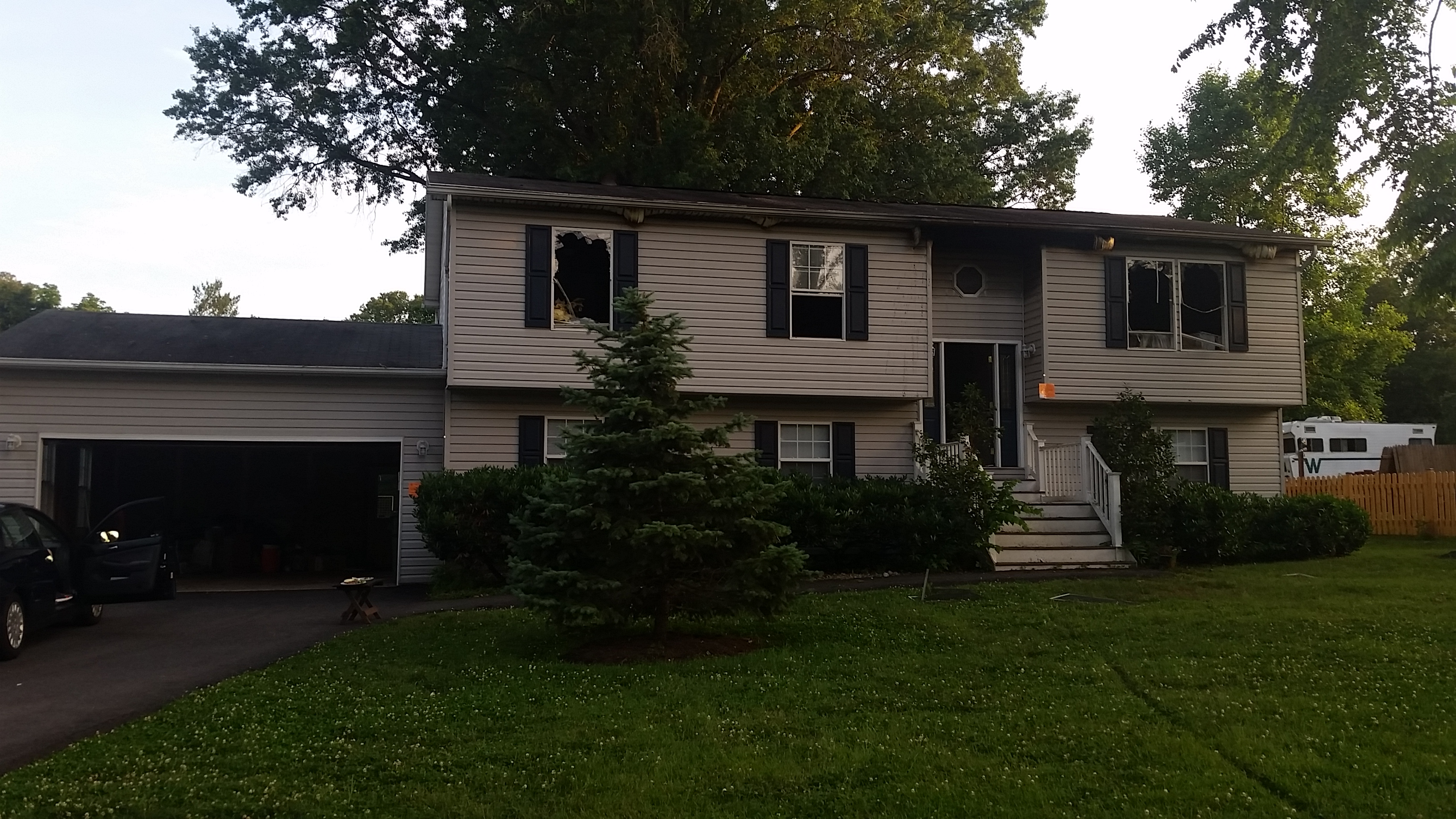Fire Damaged Home - Front View BEFORE, insurance repair contractor