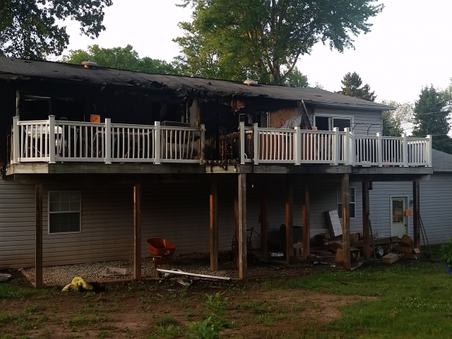 Fire Damaged Home - Back View BEFORE, insurance repair contractor