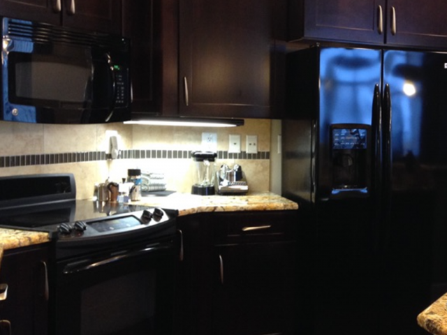 Fire Damaged Kitchen AFTER, insurance repair contractor